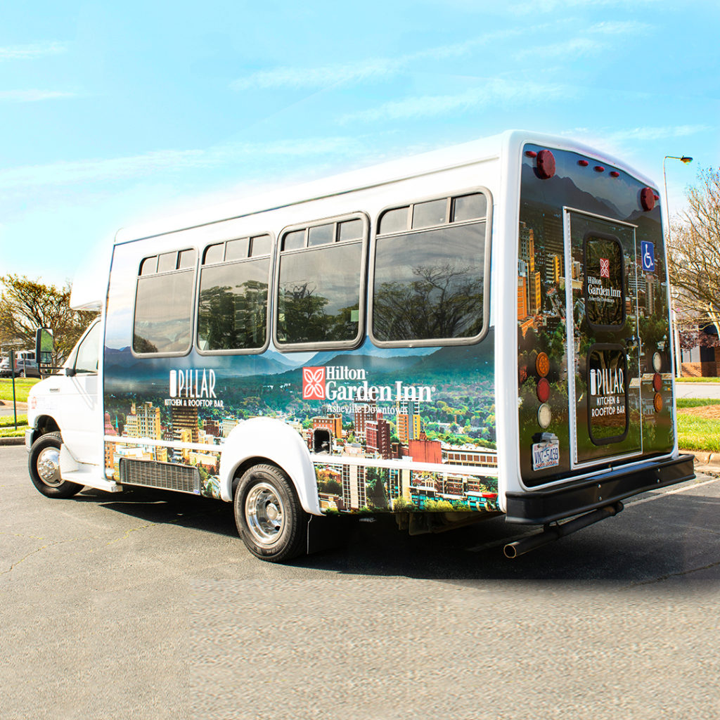 Quality Oil/Hilton Gardens       shuttle bus at the Asheville, NC location; This is a 3M vehicle wrap with cut vinyl decals.