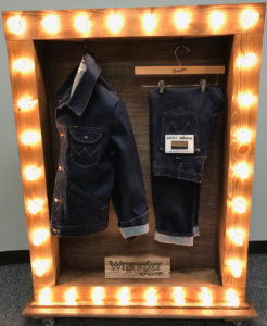 This custom rolling shadow box with engraved logo board and lighting was made completely at Sharpe Co.  This is used on display in the VF Jeanswear NY Showroom as well as the office located in Greensboro, NC.